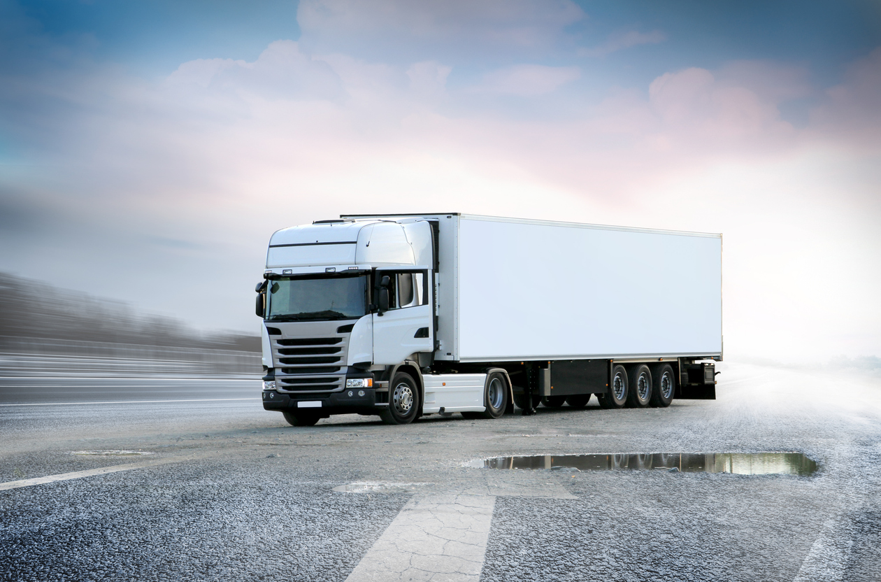 White Lorry big truck on grunge road with sky in background, isolated with clipping path